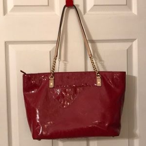 Red patent leather Michael Kors bag